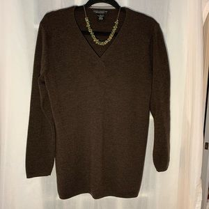 Brown v-neck sweater with necklace